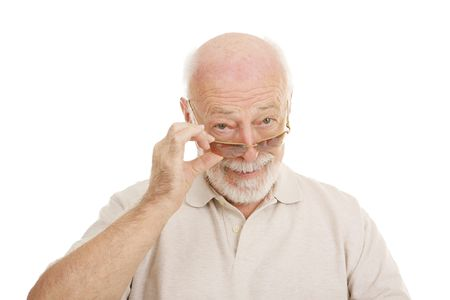 testing vision: Handsome senior man looking at you over the rim of his stylish sunglasses.  Isolated on white.