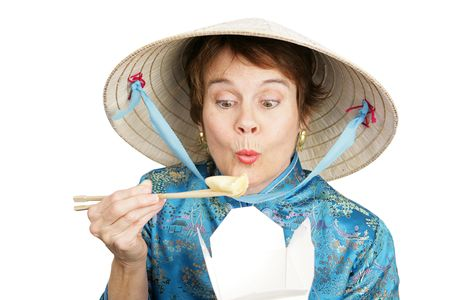 Tourist in Chinese clothing eating a dumpling from a takeout container.  Isolated on white. photo