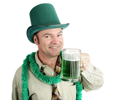 Man celebrating his Irish heritage on St. Patricks Day, making a toast with green beer.   photo