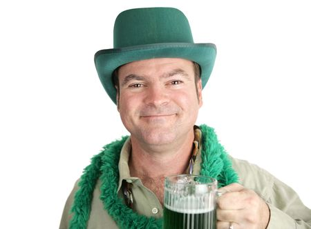 Irish man, a bit tipsy, smiling with his green beer on St. Patricks Day.  Isolated on white.
