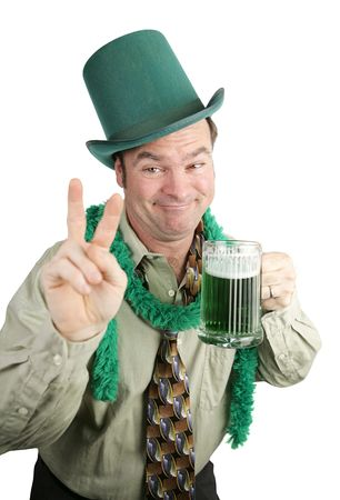 Very drunk man on St Patricks Day drinking beer and making a peace sign.  Isolated on white. photo