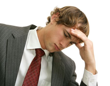 graduation suit: Young businessman overwhelmed with job stress.  Isolatd on white. Stock Photo