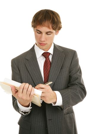 Handsome young businessman taking notes.  Isolated on white.
