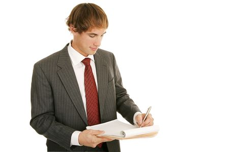 graduation suit: Handsome young businessman taking notes.  Isolated on white.