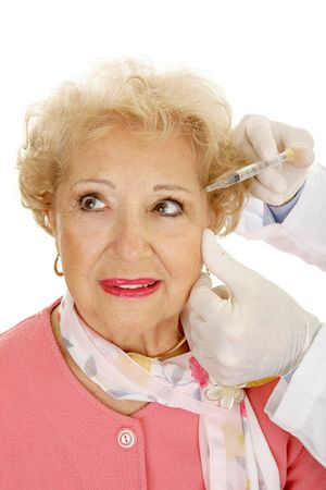 Senior woman receiving cosmetic injections for facial rejuvenation.  White Background