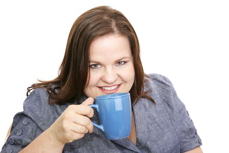 perky: Beautiful plus-sized model enjoying a cup of coffee.  Isolated on white.   Stock Photo