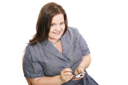 plus sized: Pretty plus sized businesswoman checking appointments on her PDA.  Isolated on white.