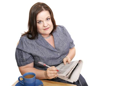 classifieds: Plus-sized businesswoman reads classifieds, discouraged by poor job market.  Isolated on white.