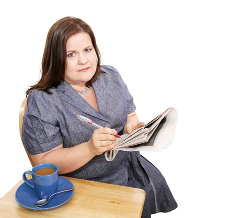 Beautiful plus sized businesswoman circling classified ads in the paper.  Isolated on white. photo