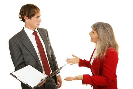 Young businessman being confronted by his angry female boss.  Isolated on white.   photo