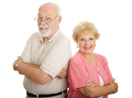 Good looking senior couple with glasses.  Isolated on white.   photo