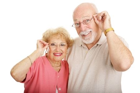 wearing glasses: Attractive senior couple wearing glasses.  Isolated on white.
