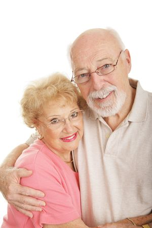 Happy seniors wearing their new glasses.  Isolated on white.   photo
