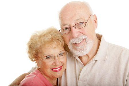 年配のカップルは、眼鏡をかけています。白い背景。