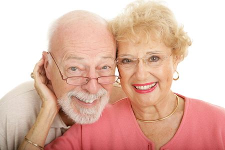 Attractive senior couple in modern, fashionable glasses.  Part of my optical series.  Isolated on white