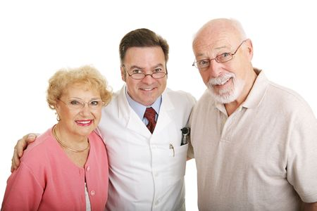 Senior couple posing in their new glasses with their optometrist.  Isolated on white. Stock Photo