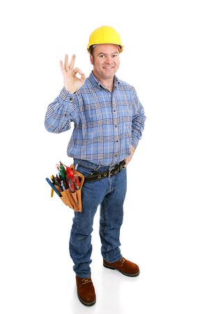 Authentic construction worker giving the a-okay sign with his fingers.  Full body isolated on white.