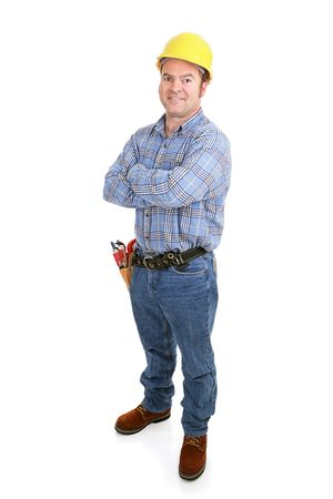 Authentic construction worker smiling with arms crossed.  Isolated on white.   Stock Photo - 2461140
