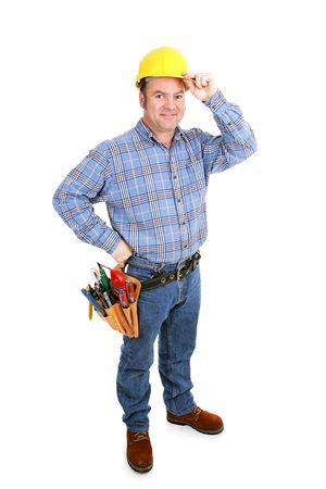 journeyman technician: Authentic construction worker tipping his hardhat.  Full Body isolated on white.   Stock Photo