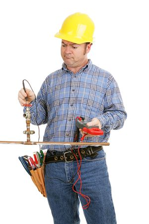 Electrician trying to repair plumbing using a voltage meter.  Isolated on white. Stock Photo - 2461151