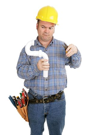Electrician confused by plumbing job.  Isolated on white.   photo