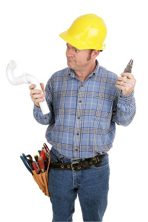 Electrician trying to use the wrong tools on a plumbing job.  Isolated on white.