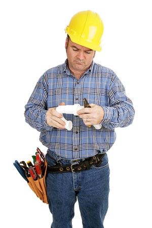 Electrician having trouble assembling plumbing pipe.  Isolated on white.   photo