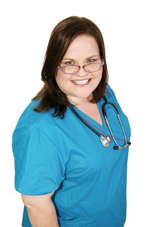 plus sized: Beautiful plus sized woman in nursing scrubs.  Isolated on white.   Stock Photo