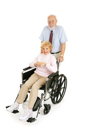 Senior man pushing his wife in wheelchair.  Full body isolated on white.   photo