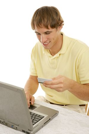Handsome college age man shopping on-line.  Vertical view on white background. Stock Photo - 2539322