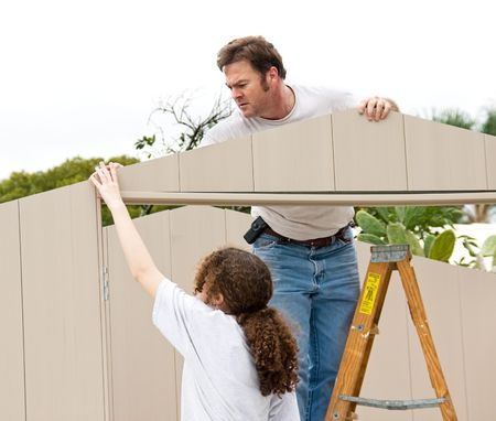 Father and daughter working on a home improvement project together.   photo