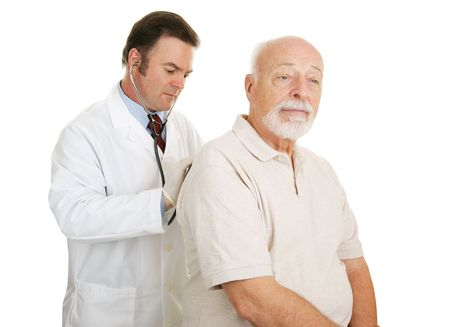 both: Doctor examining senior man.  Both have serious expressions.  Isolated on white.   Stock Photo