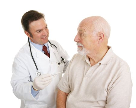 Senior man at the doctor finding out his temperature is normal.  Isolated on white.