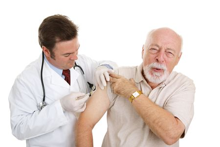 Senior man getting a painful injection from his doctor.  Isolated on white.