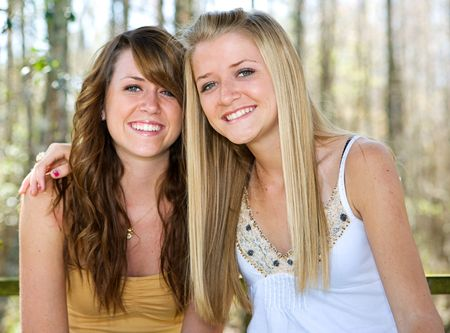 Portrait of beautiful teen sisters in natural setting.  Focus on blond girl in foreground. Stock Photo - 2607661