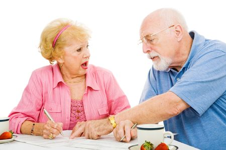 absentee: Senior woman offended by her husband telling her how to vote.  Isolated on white. Stock Photo