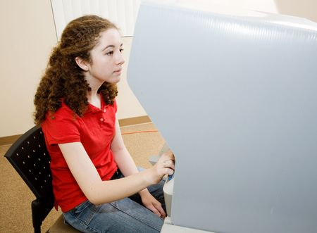 electronic voting: Eighteen year old girl votes for the first time on modern touch screen machine.    Stock Photo