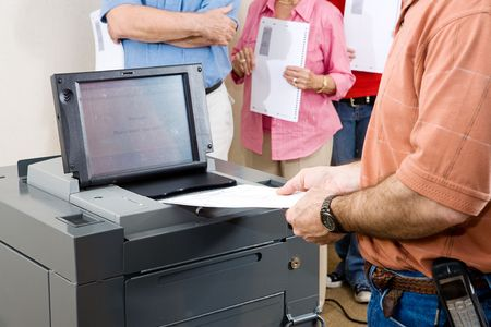 electronic voting: Closeup of a man feeding his ballot into one of Floridas new optical scan voting machines.