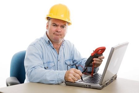 Confused electrician trying to fix a laptop computer using a voltage meter.  Isolated on white. photo