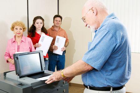 voting: Senior man voting on Floridas optical scanning machine.   Stock Photo