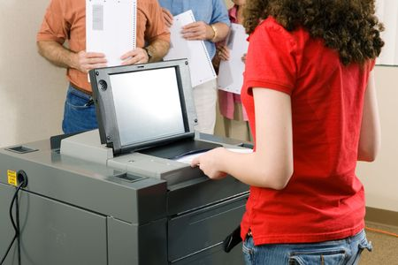 voting: Young woman votes on floridas newest optical scanning machine.   Stock Photo