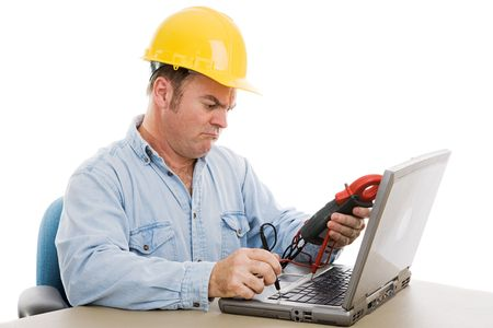 journeyman technician: Electrician using a voltage meter to try and fix a laptop computer.  Isolated on white.   Stock Photo