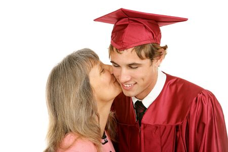Young graduate receiving a kiss from his mother.  Isolated on white.