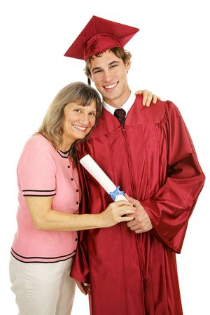 Graduate posing in cap and gown with his proud mother.  Isolated on white.