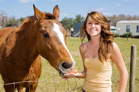 tube top: Beautiful teen girl on the farm with her horse.   Stock Photo