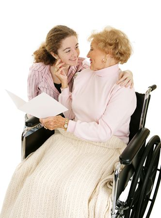 Grandmother receiving get well or mothers day card from granddaughter. Isolated on white.