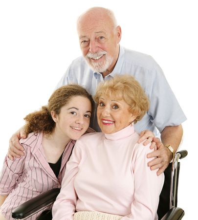 hospice: Portrait of loving grandparents and granddaughter.  Isolated on white.