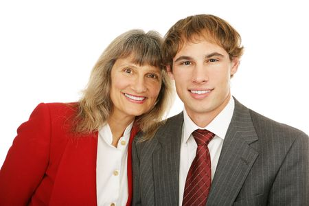 Portrait of a mature businesswoman and her young male protege.  Isolated on white.   photo