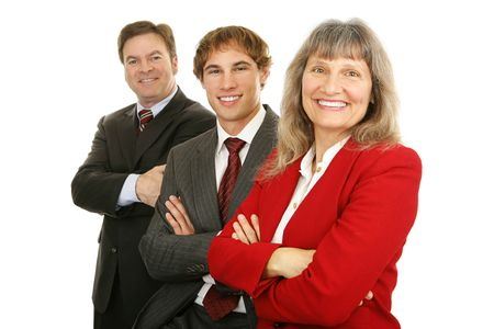 Happy, diverse business team with woman leader out in front.  Isolated on white. photo