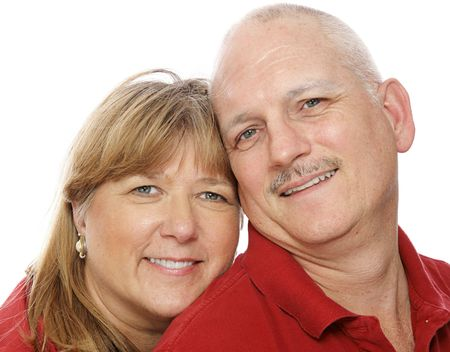 Closeup headshot of a mature couple in love.  White background. photo